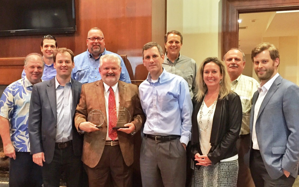 Team Max Alley and Team Family Dollar Real Estate posing with the 2015 Developer of the Year Award at the Family Dollar Annual Real Estate Developers Dinner October 14, 2015